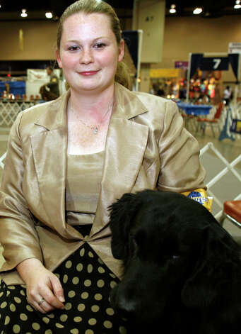 Tiffany Knox with Boo, a Flat-Coated Retriever, at the River City Cluster of Dog Shows on July 11, 2009 at the Convention Center. Photo: J. Michael Short, For The Express-News / THE SAN ANTONIO EXPRESS-NEWS/210 SA