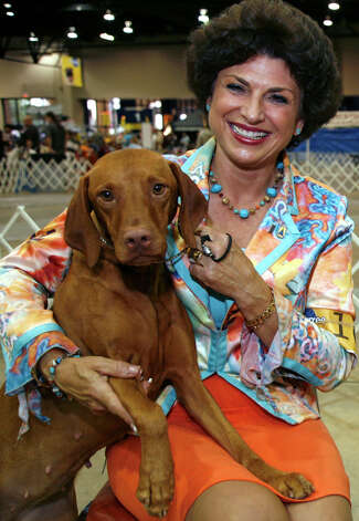 Linda Clark with Flirt, a Viszla, at the River City Cluster of Dog Shows on July 11, 2009 at the Convention Center. Photo: J. Michael Short, For The Express-News / THE SAN ANTONIO EXPRESS-NEWS/210 SA