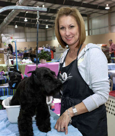 Kim Griffin stand with Raven at the River City Cluster of Dog Shows on March 10, 2012 at Freeman Coliseum Exhibition Hall. Photo: J. Michael Short, For The Express-News / THE SAN ANTONIO EXPRESS-NEWS
