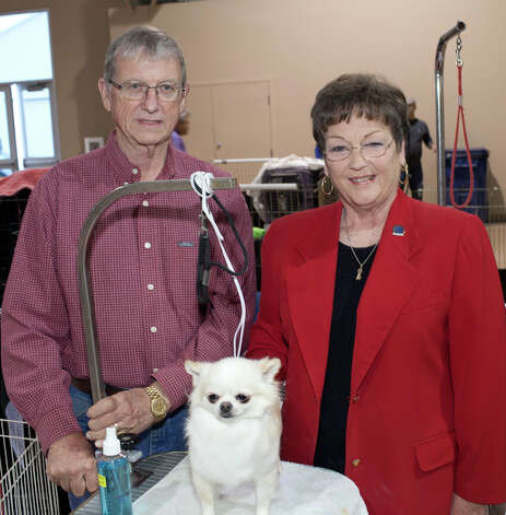 Don and Sharon Boyd stand with Abby at the River City Cluster of Dog Shows on March 10, 2012 at Freeman Coliseum Exhibition Hall. Photo: J. Michael Short, For The Express-News / THE SAN ANTONIO EXPRESS-NEWS