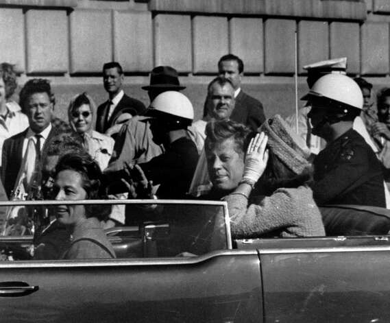 FILE - This Nov. 22, 1963 file photo shows President John F. Kennedy riding in motorcade with first lady Jacqueline
