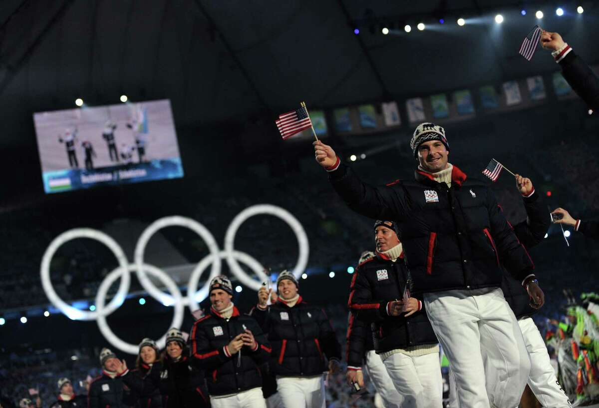 Athletes and team members of the US acknowledge the crowd during the opening ceremony for the Vancouver Winter Olympics at BC place in Vancouver on Feb.2, 2010. . AFP PHOTO / ADRIAN DENNIS (ADRIAN DENNIS/AFP/Getty Images)