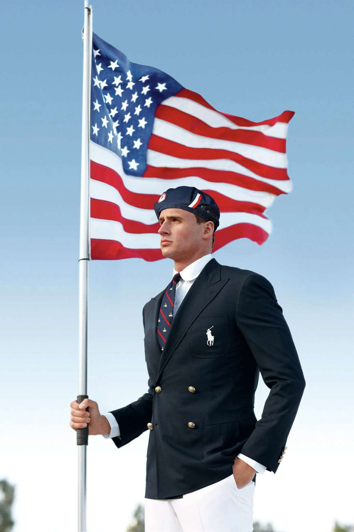 This product image released by Ralph Lauren shows U.S. Olympic swimmer Ryan Lochte modeling the the official Team USA opening ceremony parade uniform. (AP Photo/Ralph Lauren)