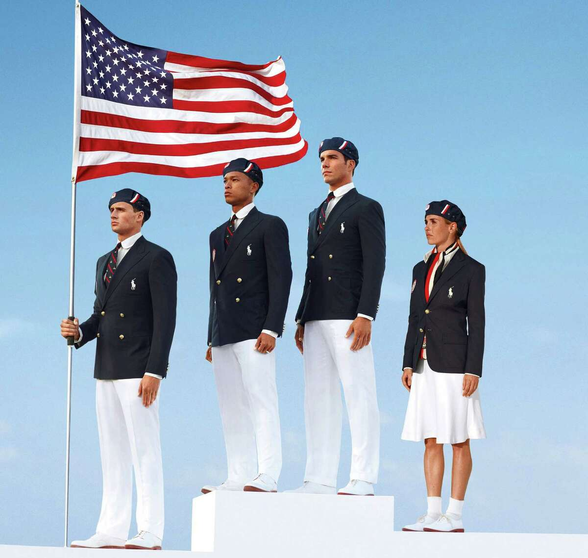 This product image released by Ralph Lauren shows U.S. Olympic athletes, from left, swimmer Ryan Lochte, decathlete Bryan Clay, rower Giuseppe Lanzone and soccer player Heather Mitts modeling the the official Team USA opening ceremony parade uniform. (AP Photo/Ralph Lauren)