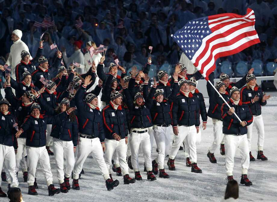 Flag bearer Mark Grimmette of the United States leads his team through the stadium during the Opening Ceremony of the 2010 Vancouver Winter Olympics at BC Place on February 12, 2010 in Vancouver, Canada. Photo: Getty Images