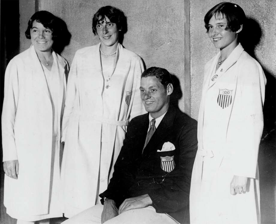 This group of United States Olympic team members were happy to be home again when they arrived on the Pres. Roosevelt, August 22, 1928 in New York, or at least they appeared to be. They are shown as they appeared at a reception for the athletes at the McAipin hotel after their arrival. From left to right: Katharine Maguire and Dolores Boeck of St. Louis; Johnny Weissmuller, champion swimmer and Elizabeth Robinson, 17 year old sprint champion, both of Chicago. Photo: AP / 1928 AP