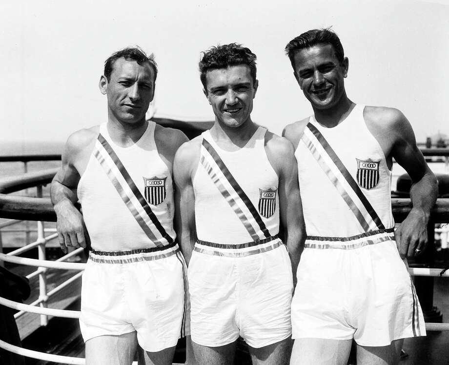 U.S 1500 meter team pose on board the U.S liner 'Manhattan', en route to the Olympics in Berlin, Germany, July. 22, 1936. From left, Glenn Cunningham, Archie San Romani, Gene Venzke. Photo: AP / 1936 AP