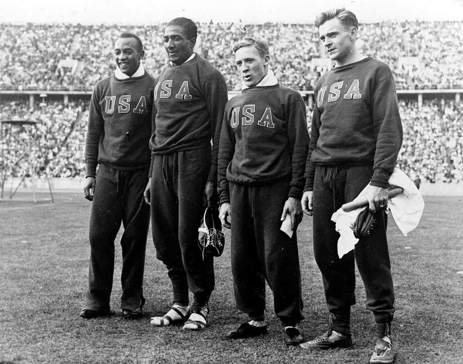 America won the men's Olympic Games 4 x 100 metres relay, in Berlin, Germany, Aug. 9, 1936, in a new World record time of 39.8 seconds. The team from left to right; Jesse Owens, Ralph Metcalfe, Foy Draper and Frank Wykoff. Photo: AP / AP1936