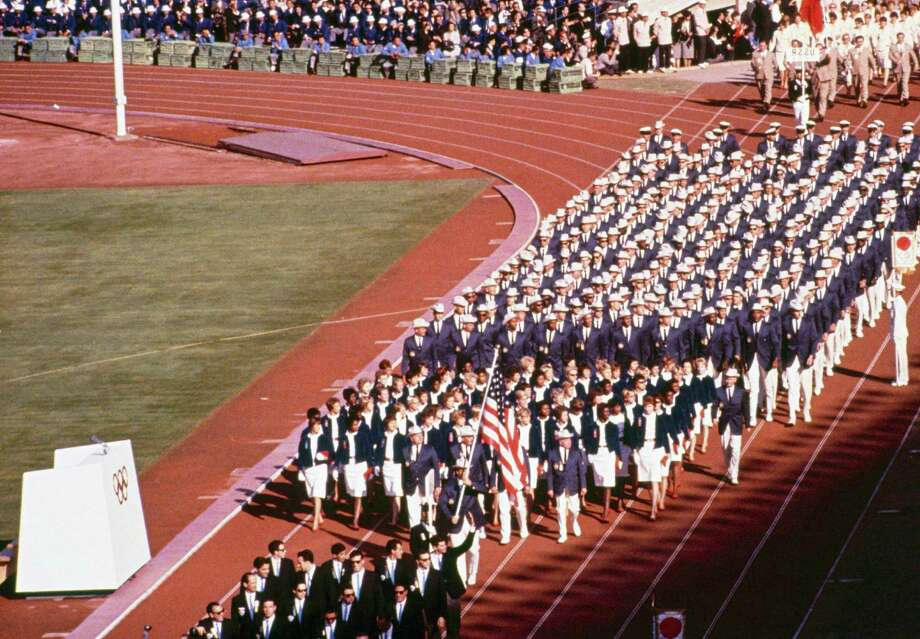 Pictured here is the US team entering the Tokyo Stadium at the opening ceremonies of the 1964 Summer Olympics in Tokyo, Japan, Oct. 10, 1964. Photo: AP / 1964 AP