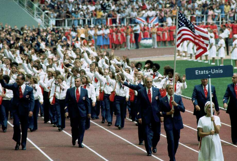 Officials and athletes on the United States Olympic team wave to spectators as they march during the opening of the Games of the XXI Olympiad held in Montreal, July 17, 1976. Photo: AP / 1976 AP
