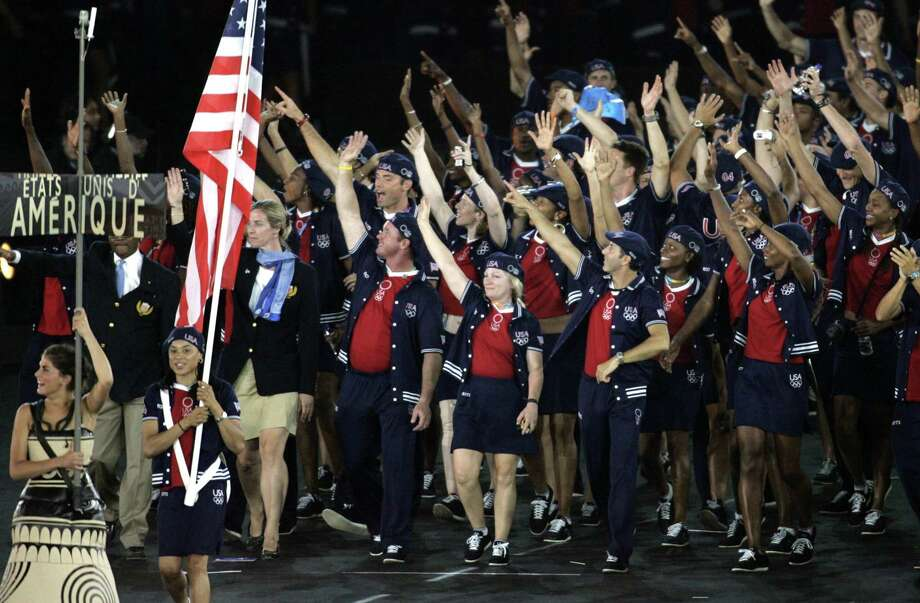 Members of the United States delegation, including WNBA basketball player Dawn Staley as the flagbearer, enter the stadium during the Opening Ceremony of the 2004 Olympic Games in Athens, Friday, Aug. 13, 2004. Photo: ERIC RISBERG, ASSOCIATED PRESS / AP2004