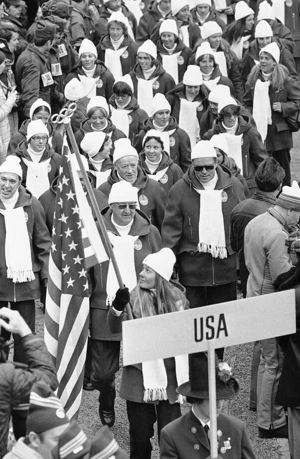 Alpine skier Cindy Nelson, of Lutsen, Mn., is the flag-bearer for the United States team marching inside the Bergisel stadium in the opening ceremony of the 12th Winter Olympic Games on Feb. 4, 1976 in Innsbruck. Photo: Anonymous, AP / 1976 AP