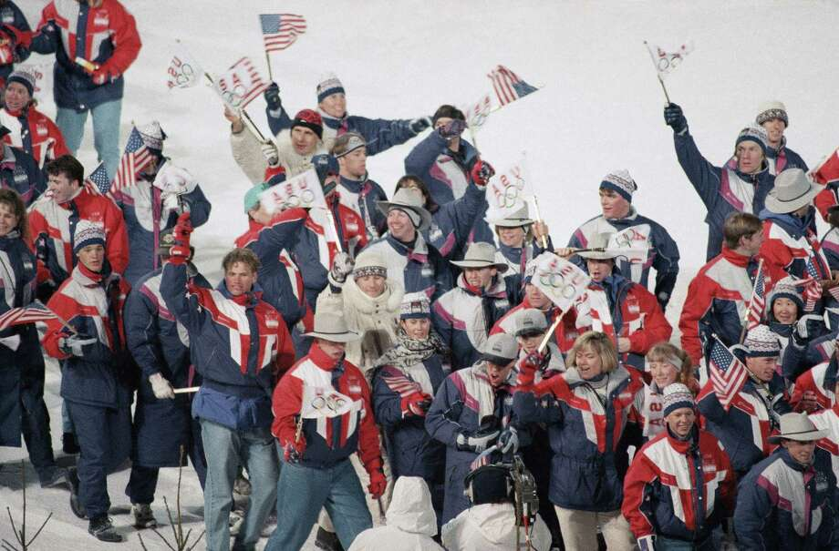 U.S. athletes wave flags as they enter the Lysgardsbakkene ski arena in Lillehammer, Feb. 27, 1994 during the closing ceremony of the XVII Olympic Winter Games. Photo: Eric Draper, AP / 1994 AP
