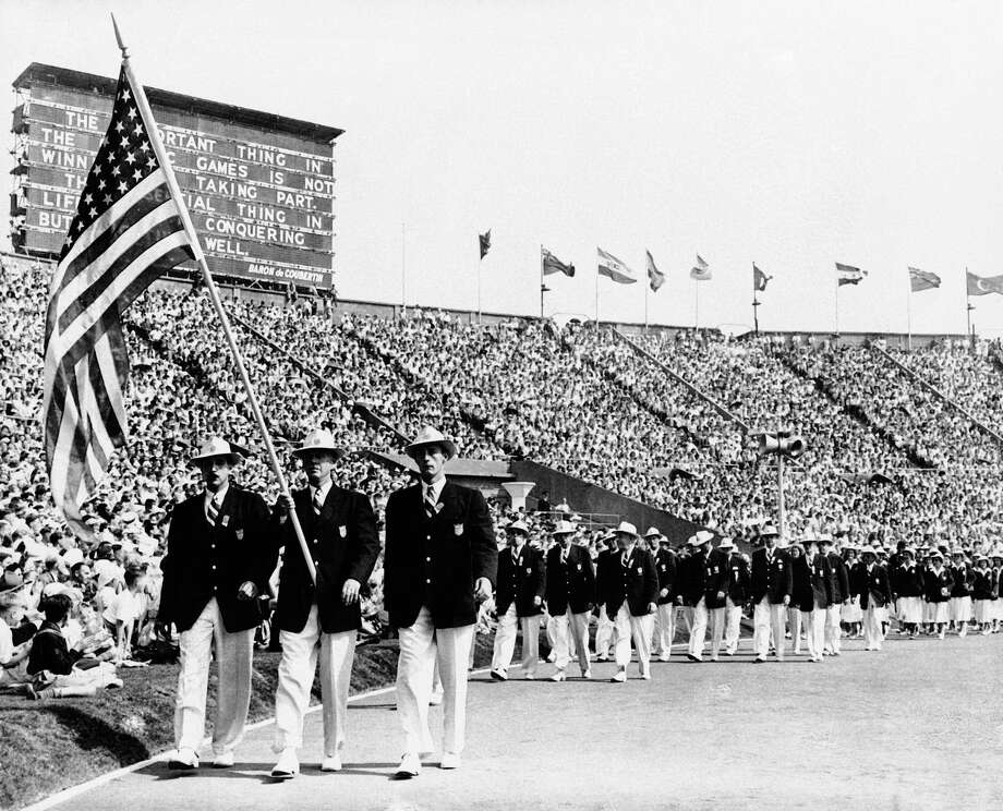 Ralph Craig, who won the 100- and 200-meter dashes in the 1912 Olympic games in Stockholm, and was a member of the U.S. Olympic Yachting team in the 1948 games, carries the American flag in the parade of the nations at the opening of the Olympic games in London's Wembley Stadium.  Athletes bought their own uniforms, and some their own food. They stayed in private homes, schools and military barracks. If eggs appeared on the training menu, it was a cause for celebration. When London hosted the Olympics in 1948, organizers did it on the cheap, and they made no apologies about it. Photo: Uncredited, ASSOCIATED PRESS / AP1948