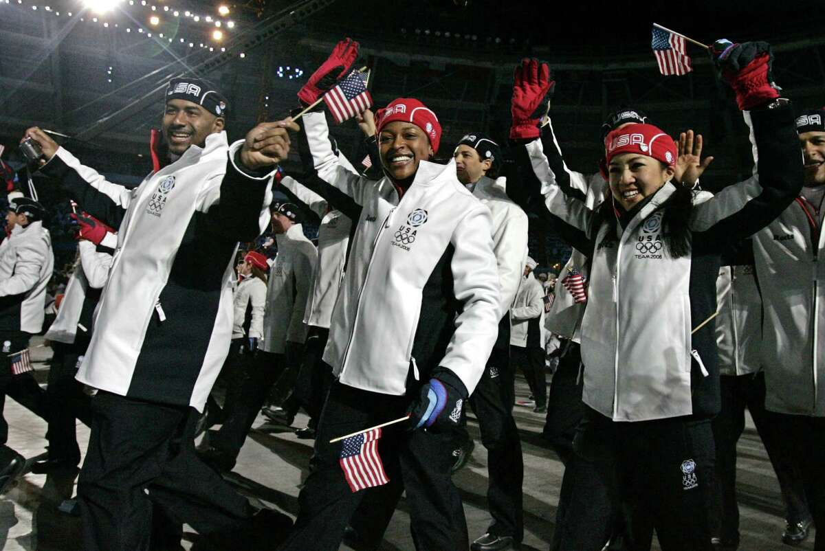 Michelle Kwan, right, and Vonetta Flowers, center, arrive with the United States team during the opening ceremony for the 2006 Winter Olympics in Turin, Italy, Friday, Feb. 10, 2006.
