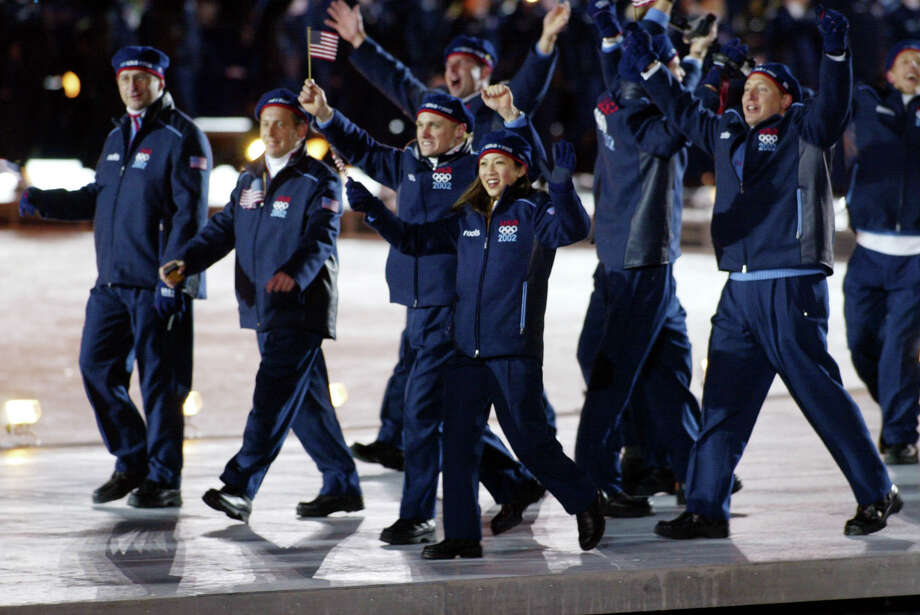 USA's figure skater Michelle Kwan, center, joins her teammates as they enter the Rice-Eccles Olympic stadium during the opening ceremonies of the 2002 Winter Olympics in Salt Lake City Friday, Feb. 8, 2002. Photo: DOUG MILLS, AP / AP