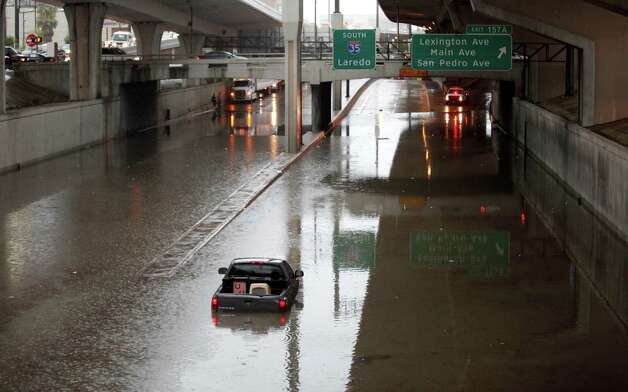 A truck is seen Wednesday July 11, 2012 in the flooded lower level of I-35 in downtown. Photo: William Luther, San Antonio Express-News / SAN ANTONIO EXPRESS-NEWS