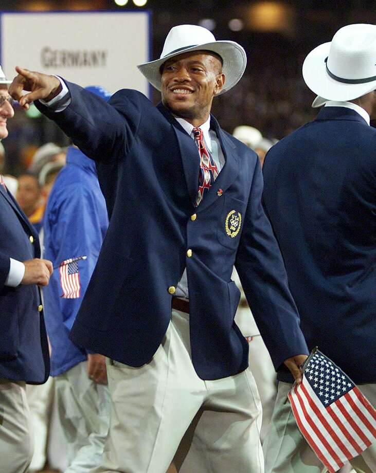 American sprinter and 100 meter world record holder Maurice Greene jokes around during the parade of athletes at the opening ceremonies of the 2000 Summer Olympics in Sydney, Australia, Friday, Sept. 15, 2000.  Photo: RYAN REMIORZ, ASSOCIATED PRESS / AP2000