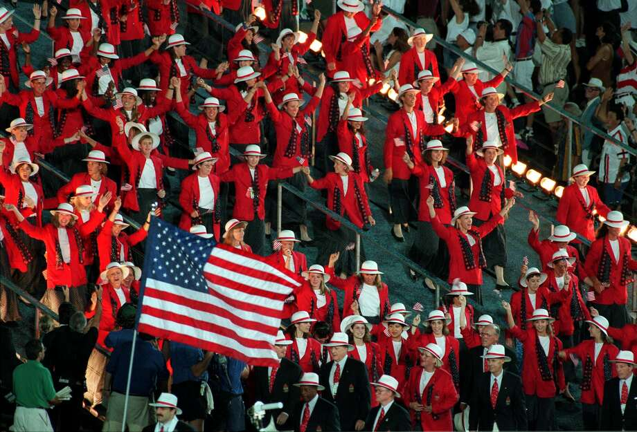 Members of the United States Olympic delegation wave as they march in the Parade of Nations at  Olympic Stadium for the opening ceremony for the Centennial Olympic Games in Atlanta Friday July 19,1996. Photo: MICHEL LIPCHITZ, AP / 1996 AP