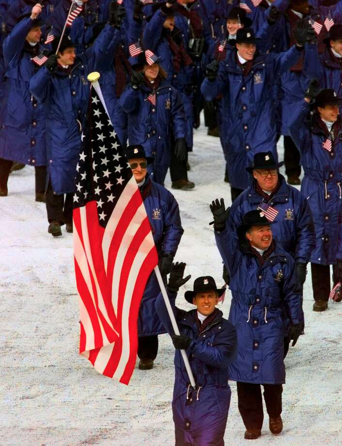 The United States team, led by flagbearer Eric Flaim, enters the stadium for the Opening Ceremony of the XVIII Winter Olympics at the Minami Nagano Sports Park in Nagano, Japan, Saturday, Feb. 7, 1998. Photo: ED REINKE, AP / 1998 AP