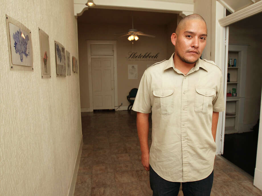 "Rigo Luna organized the exhibit ""Sketch book"" which includes work from the San Antonio artist Albert Alvarez and Brooklyn artist Kevin Ragnott's sketchbooks and prints made from their drawings Thursday July 5, 2012 at Studio One Zero Three. The new gallery shares space with a hair salon. Photo: Julysa Sosa / SAN ANTONIO EXPRESS-NEWS"
