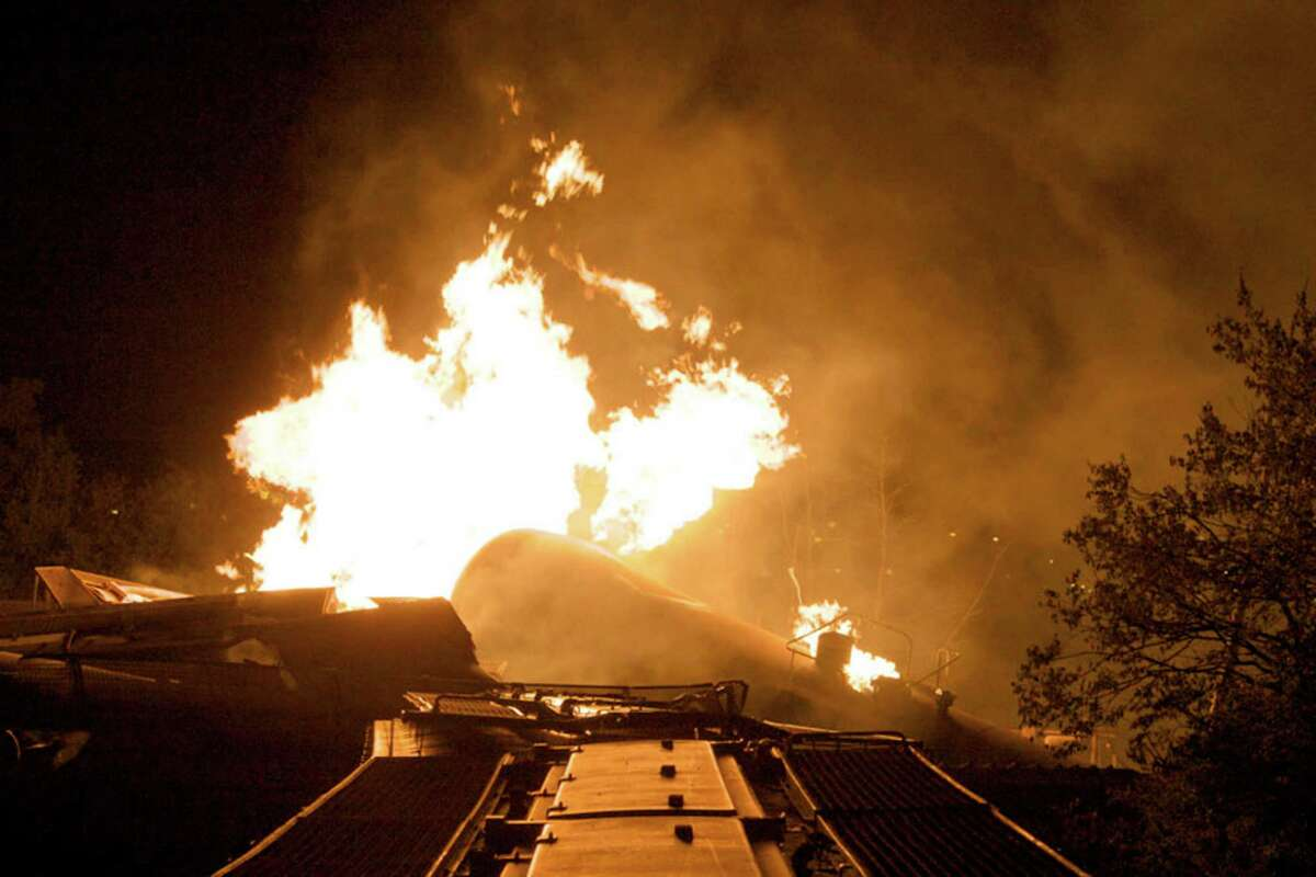 Flames rise from a derailed freight train early Wednesday in Columbus Ohio. Part of a freight train derailed and caught fire in Ohio's capital city early Wednesday, shooting flames skyward into the darkness and prompting the evacuation of a mile-wide area as firefighters and hazardous materials crews worked to determine what was burning and contain the blaze.