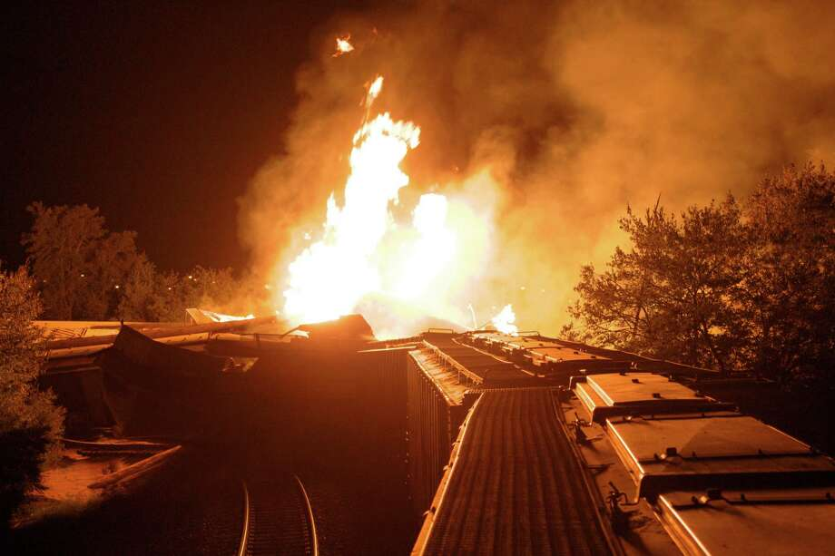 Flames rise from a derailed freight train  early Wednesdayin Columbus, Ohio.  Part of a freight train derailed and caught fire in Ohio's capital city early Wednesday, shooting flames skyward into the darkness and prompting the evacuation of a mile-wide area as firefighters and hazardous materials crews worked to determine what was burning and contain the blaze. Photo: Ap