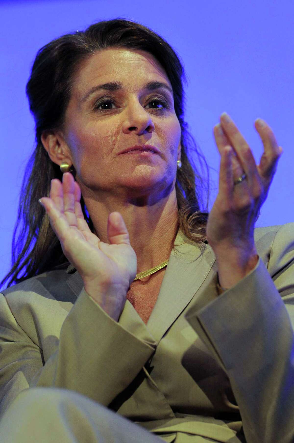 Melinda Gates, co-founder and co-chair of the Bill & Melinda Gates Foundation, applauds during the London Summit on Family Planning organized by the UK Government and the Bill & Melinda Gates Foundation with the United Nations Population Fund, UNFPA, in central London Wednesday July 11, 2012.