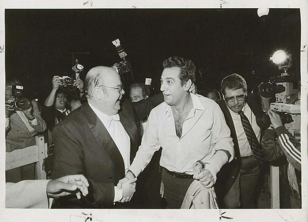 San Francisco Opera General Manager Terence McEwen (left) greets Placido Domingo in September 1983, after the singer flew in to replace a tenor who had lost his voice.