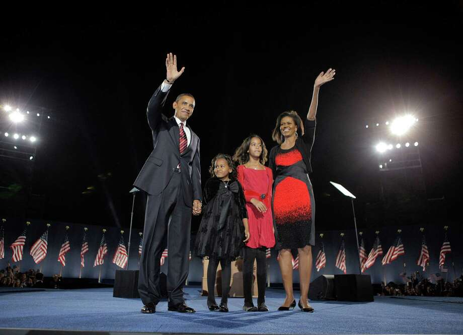 FILE-   This Nov. 4, 2008 file photo shows President-elect Barack Obama, left, his wife Michelle Obama, right, and two daughters, Sasha, 7, and Malia, 10, second from right, as they wave at the election night rally in Chicago. Sony Electronics and the Nielsen television research company collaborated on a survey ranking TV's most memorable moments. Other TV events include, the Sept. 11 attacks in 2001, Hurricane Katrina in 2005, the O.J. Simpson murder trial verdict in 1995 and the death of Osama bin Laden in 2011.  (AP Photo/Jae C. Hong, File) Photo: Jae C. Hong, Associated Press / 2008 AP