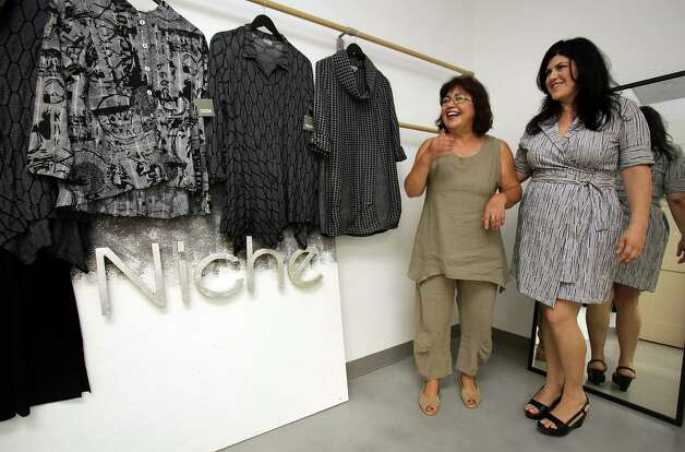 Ayse Derman, right, and her mother Nilgun Derman own and operate Niche, a clothing line designed here in San Antonio, made in central Texas, and shipped locally and nationally to prominent clothing stores. Ayse is the Creative Director and Nilgun is the Head Designer.  Monday, July 9, 2012. Photo: BOB OWEN / © 2012 San Antonio Express-News