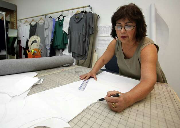 Nilgun Derman, Head Designer and President of Niche, a clothing line designed here in San Antonio, made in central Texas, and shipped locally and nationally to prominent clothing stores. Monday, July 9, 2012. Photo: BOB OWEN / © 2012 San Antonio Express-News
