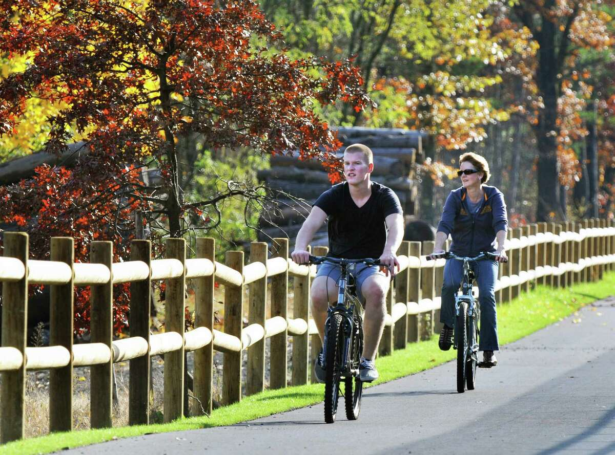 Jake Dunkelbarger, left, and his mother Cheryl Dunkelbarger ride their bikes along the Zim Smith Trail in 2010. Town board member Bill Goslin fears that the Dolomite plant will adversely affect the trail and its wetlands. (John Carl D'Annibale / Times Union)