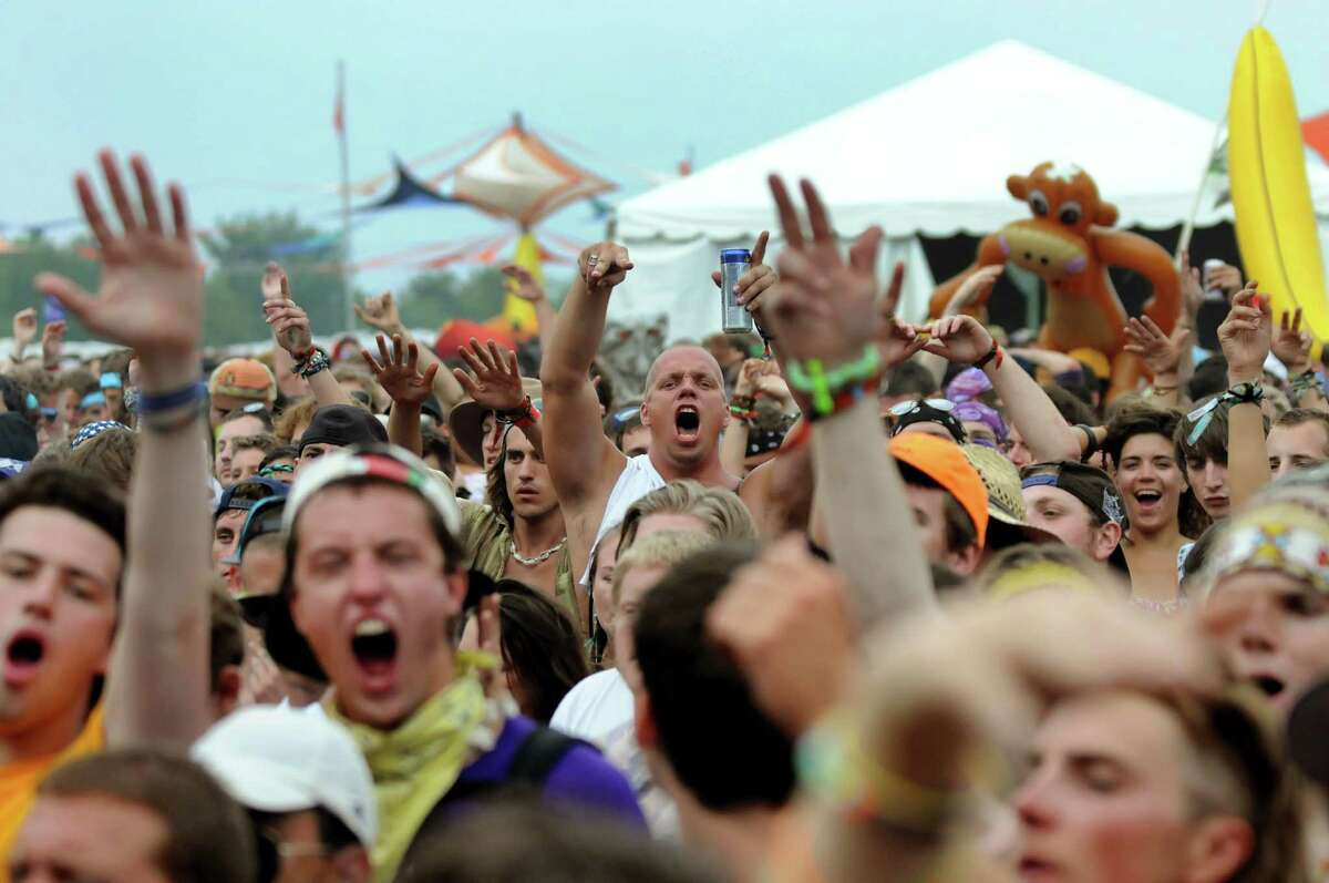 The audience cheers to the music of Break Science and RJD2 at Camp Bisco on Friday, July 8, 2011, in Pattersonville, N.Y. (Cindy Schultz / Times Union)