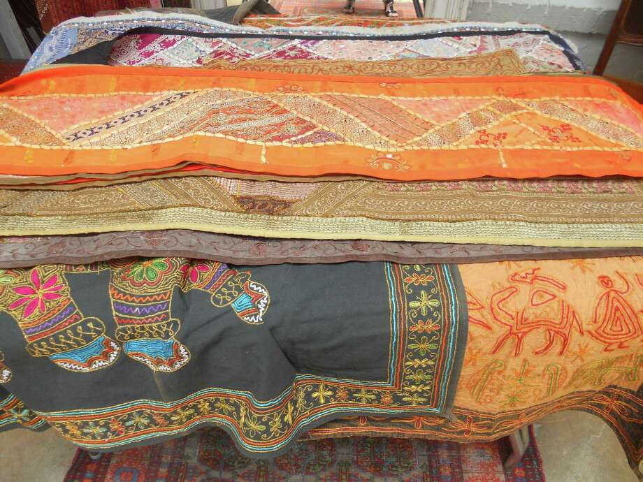 712 S. St. Mary's St.: Vintage tapestries from Afghanistan, starting at $39.99, are available at Pig Liquors. Photo: Jennifer Rodriguez, For The Express-News