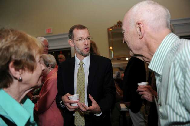 Douglas W. Elmendorf, left, the director of the Congressional Budget Office, speaks with John Caron at the Retired Men's Association meeting at the First Presbyterian Church Wednesday, July 11, 2012. Photo: Helen Neafsey / Greenwich Time