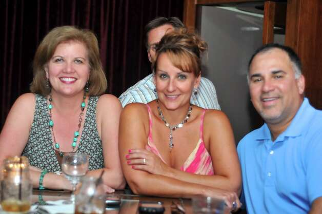 Melissa Thorne, Kathy Alvarez, and Joe Alvarez are enjoing a night at Luna. Photo: XELINA FLORES-CHASNOFF