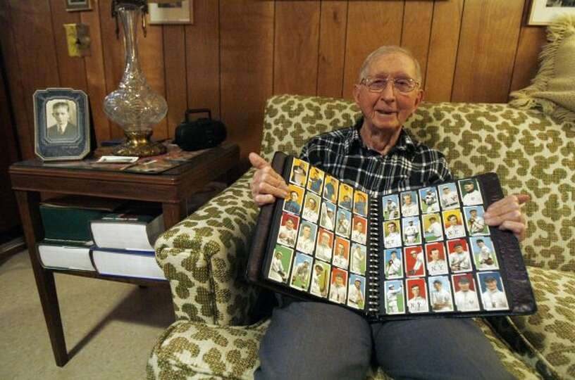 Lionel Carter Holds His Baseball Card Collection Wednesday