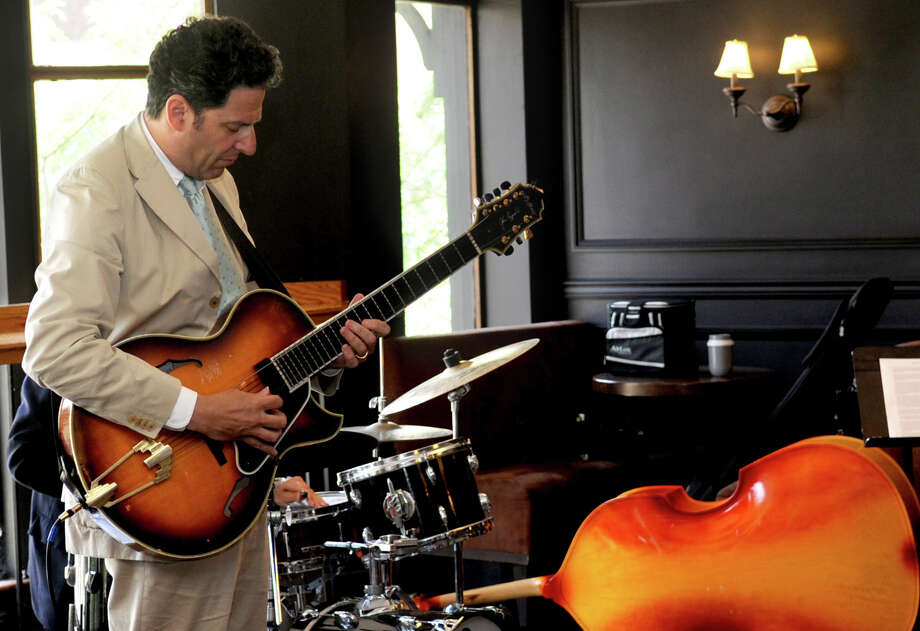 John Pizzarelli performs during a master class for the Young Artists Summer Jazz Workshop at BUtterfield 8 on Wednesday, July 11, 2012. Photo: Lindsay Niegelberg / Stamford Advocate