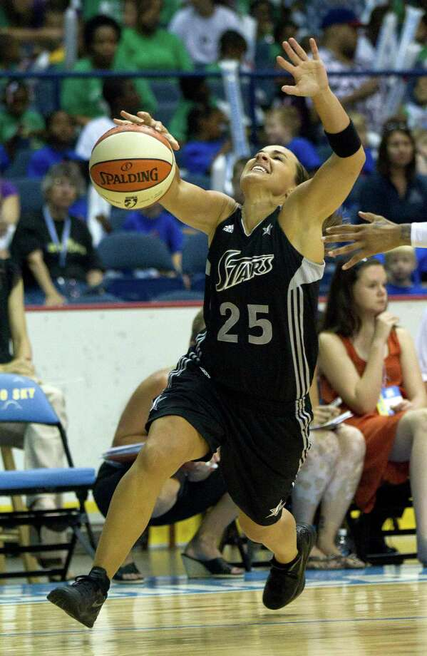 San Antonio Silver Stars guard Becky Hammon is fouled during the second half of an WNBA basketball game against the Chicago Sky, Wednesday, July 11, 2012, in Rosemont, Ill. The Silver Stars won 77-68. (AP Photo/Charles Rex Arbogast) Photo: Associated Press