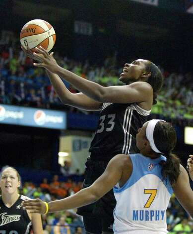 San Antonio Silver Stars' Sophia Young (33) shoots over Chicago Sky's Eshaya Murphy (7) during the second half of an WNBA basketball game Wednesday, July 11, 2012, in Rosemont, Ill. The Silver Stars won 77-68. (AP Photo/Charles Rex Arbogast) Photo: Associated Press