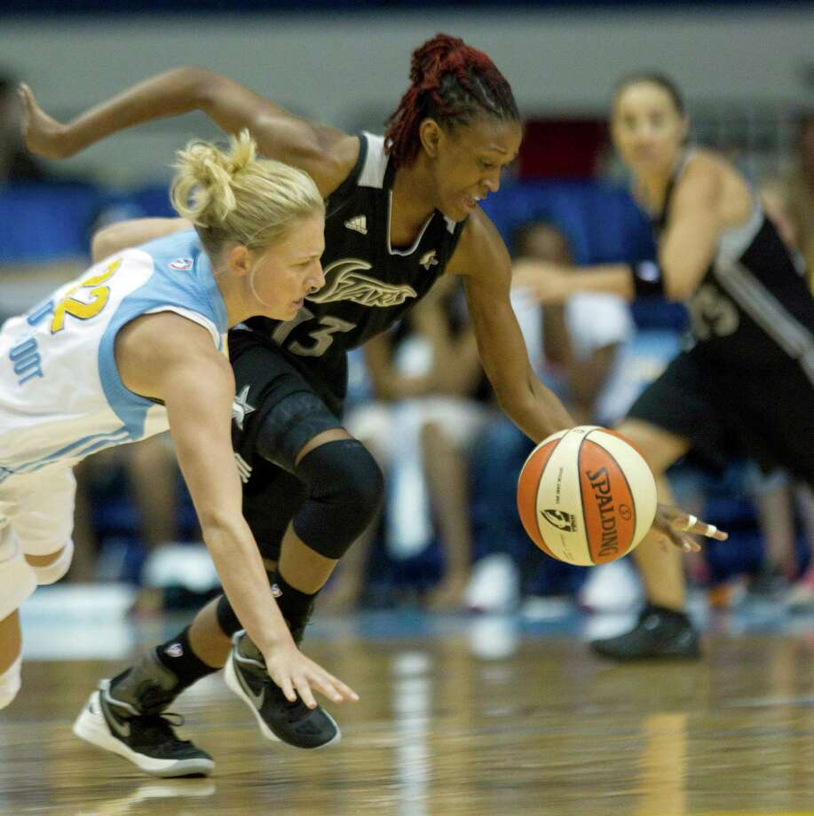 San Antonio Silver Stars' Danielle Robinson (13) steals the ball from Chicago Sky's Courtney Vandersloot during the first half of an WNBA basketball game, Wednesday, July 11, 2012, in Rosemont, Ill. (AP Photo/Charles Rex Arbogast) Photo: Associated Press