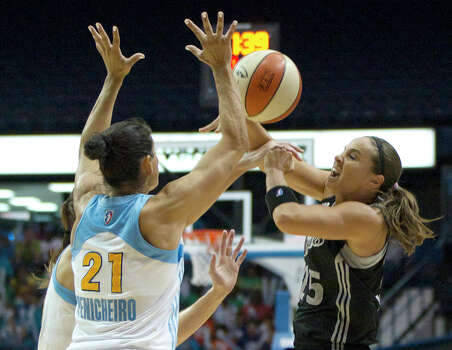 Chicago Sky's Ruth Riley, left, and Ticha Penicheiro (21) block a pass by San Antonio Silver Stars' Becky Hammon during the first half of an WNBA basketball game, Wednesday, July 11, 2012, in Rosemont, Ill. (AP Photo/Charles Rex Arbogast) Photo: Associated Press
