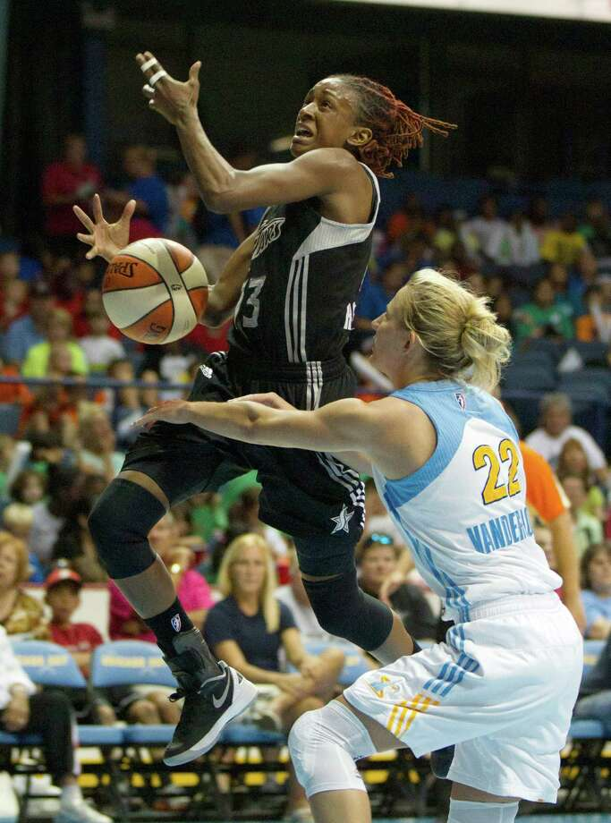 San Antonio Silver Stars' Danielle Robinson, left, is fouled by Chicago Sky's Courtney Vandersloot during the first half of an WNBA basketball game, Wednesday, July 11, 2012, in Rosemont, Ill. (AP Photo/Charles Rex Arbogast) Photo: Associated Press