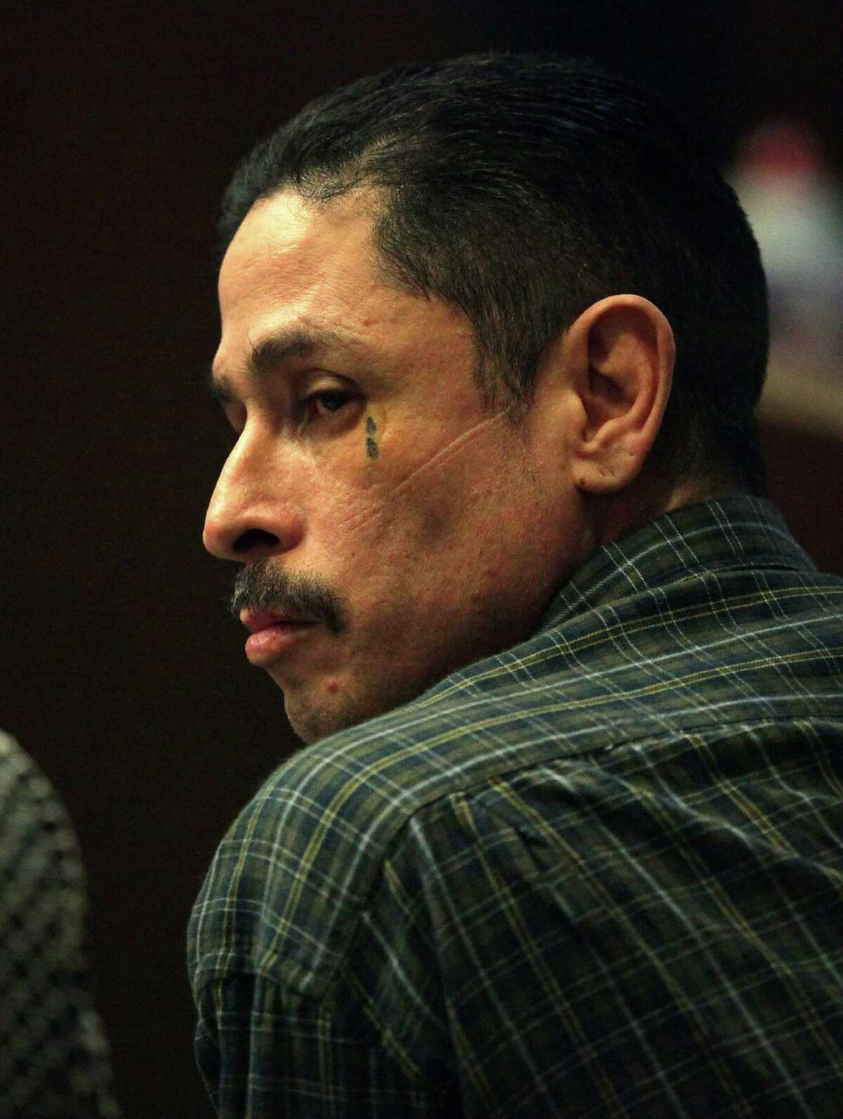 """Pretrial hearings in the trial of Bobby """"Spider"""" Moreno, in Judge Ron Rangel's 239th District Court. He is accused of kidnapping a 13 year old in 2007, injecting her with drugs and leaving her tied to a bed for weeks as he and his brother, Juan Moreno, charged neighborhood men $25 each to rape her. Juan has already been charged and received four life terms in Dec. 2010. Tuesday, July 10, 2012."""