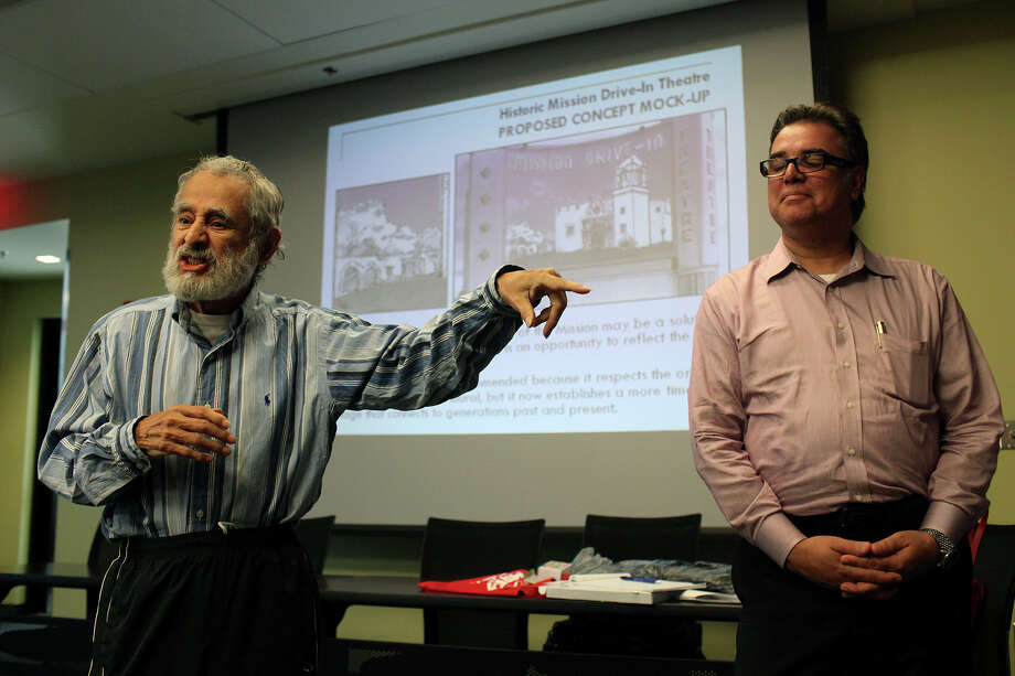 """Nick Calzoncit (left) voices his concerns to Felix Padrón, director of the city's Office of Cultural Affairs, and others at the public meeting. Padrón told the group the design touches on sensitive areas and """"is not a done deal yet."""" Photo: Lisa Krantz, San Antonio Express-News / San Antonio Express-News"""