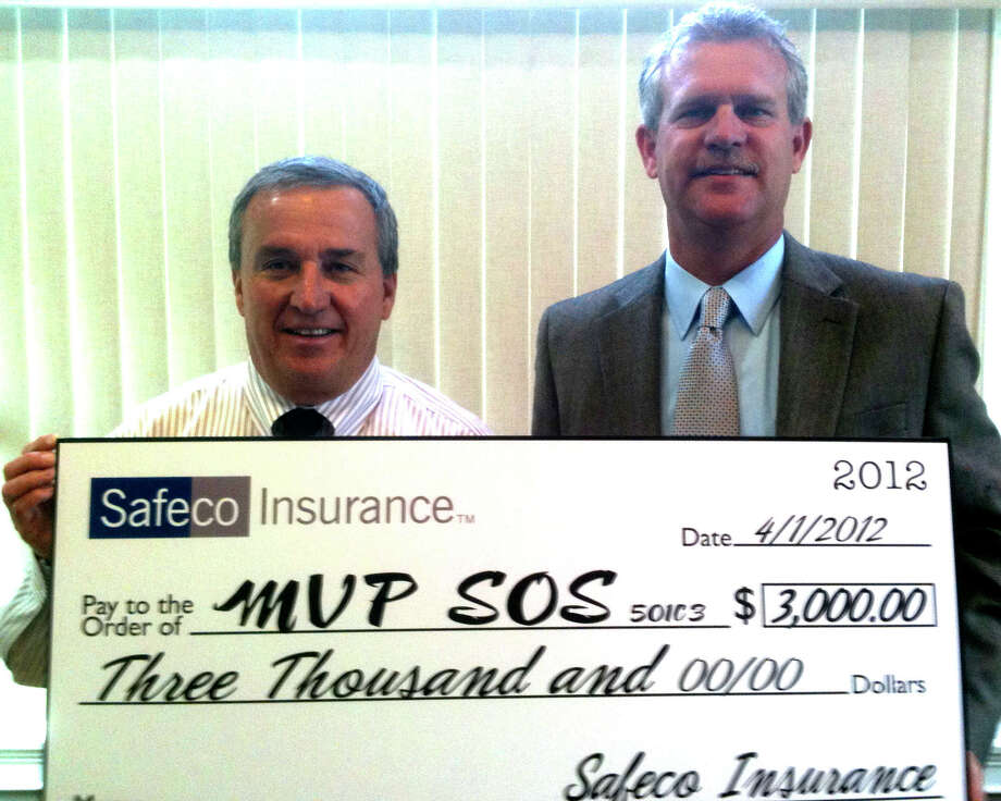 MVP-SOS treasurer Kevin Dumas, left, happily accepts a larger-than-life check for $3,000 recently on behalf of the New Milford-based charitable foundation from Safeco Insurance, represented here by Chris O'Brien, president of the O'Brien Insurance Agency of New Milford. June 2012  Courtesy of MVP-SOS Photo: Contributed Photo