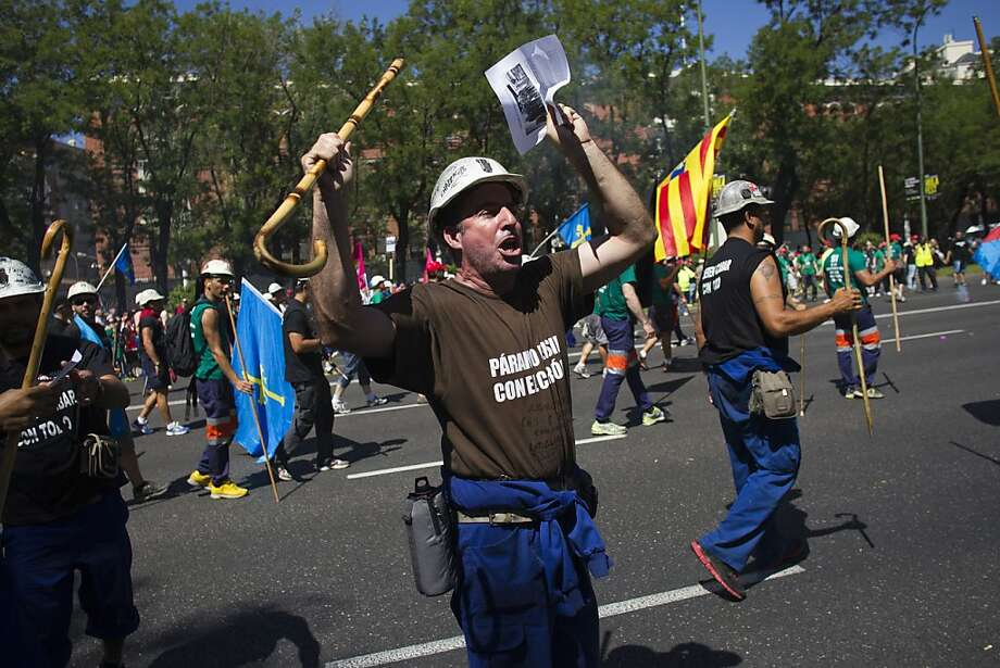 A Spanish miner raises a walking stick and shouts while taking part in a march from Asturias to protest  against government budget cuts in Madrid, Spain, on Wednesday, July 11, 2012. The demonstration tests Spanish Prime Minister Mariano Rajoy's attempt to maintain order as he pushes through the most severe budget cuts since the country returned to democracy 35 years ago. Photographer: Angel Navarrete/Bloomberg Photo: Angel Navarrete, Bloomberg