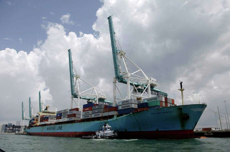 A Maersk freighter is loaded with shipping containers at the Port of Miami in Miami in May. Government statistics indicated the U.S. trade deficit in May narrowed by almost 4 percent. Photo: Lynne Sladky / AP2012