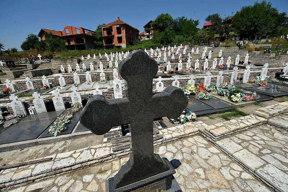 A view of the tombstones of Bosnian Serbs killed in the 1992-95 Bosnian war at a cemetery in Bratunac, near Srebrenica, on July 11, 2012. Bosnians today buried 520 victims of the 1995 Srebrenica massacre, with the two alleged masterminds of the slaughter finally on trial for genocide. About 30,000 people were gathered at a special memorial centre in Potocari, just outside Srebrenica, for the mass funeral on the 17th anniversary of the worst atrocity on European soil since World War II.  AFP PHOTO / ANDREJ ISAKOVICANDREJ ISAKOVIC/AFP/GettyImages Photo: Andrej Isakovic, AFP/Getty Images